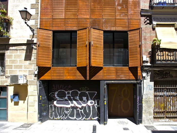 A Clever Fa 231 Ade Of Corten Steel Shutters Revitalizes San
