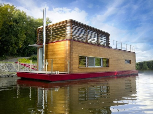 sayboat is a minimalist floating home clad with