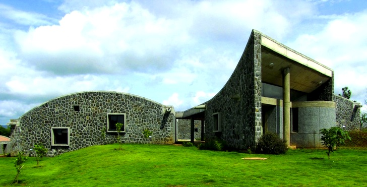 Striking Heritage School With Stone Walls And Curved Roofs