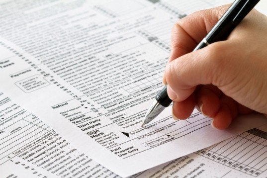 Tax form, filling out taxes, corporate tax loophole, 1040