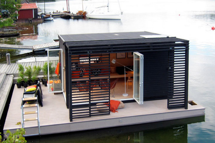 A tiny modern floating cabin powered by photovoltaic 39 s for Building a floating home