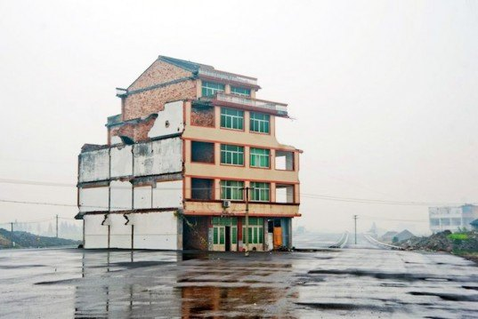 nail house, urban redevelopment, house in road, road built around house, Luo Baogen, Zhejiang province