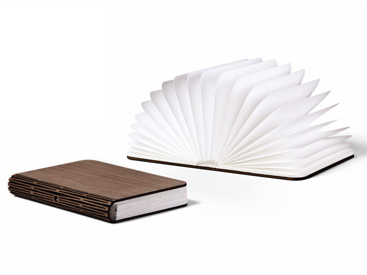 lumio hard bound book unfolds to unveil a low energy lamp