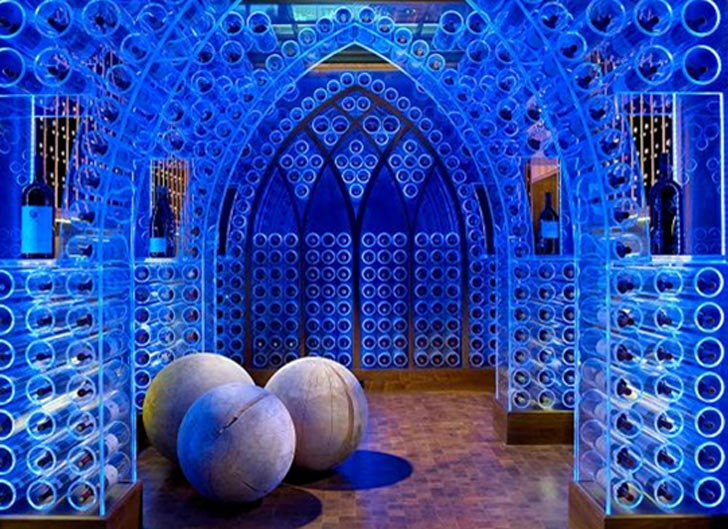 Electric Blue LED Wine Cellar with Gothic Flare by Beckwith Interiors