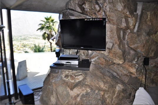 John Lautner Elrod House - Flat Screen TV installed on top of boulders, John Lautner Elrod House, john lautner, ufo house, elrod house, elrod residence, palm springs modernism, diamonds are forever, james bond, bambi and thumper, california modernism, organic architecture, lautner, palm springs architecture, la modern, la modern home tours, la home tour, modern homes la, los angeles modern, modern homes los angeles, lautner los angeles, lautner la, john lautner LA, john lautner los angeles, ufo home, flintstones home, los angeles, alien-inspired homes los angeles, space homes, space inspired home, space architecture, la design, la modern design, historic la home, historic modern la homes, historic los angeles landmarks, historic los angeles homes, architecturally significant homes, architecturally significant homes california, palm springs architecture, palm springs modern homes