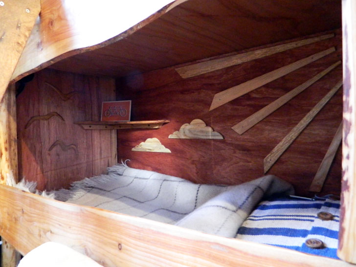 Rustic campers cosy living spaces in the back of a van for Campervan interior designs