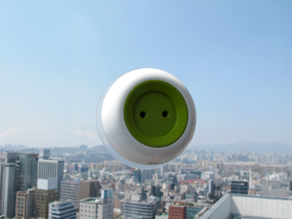 Window Socket: Portable Solar-Powered Outlet Sticks to Windows, Charges Small Electronics