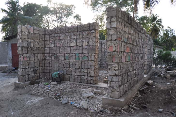 The Gabion House in Croix des Bouquets, Port au Prince, Haiti uses cinderblock rubble taken from the 2010 earthquake and repurposes the material more durable, earthquake-proof building blocks known as 'modified' gabion baskets.
