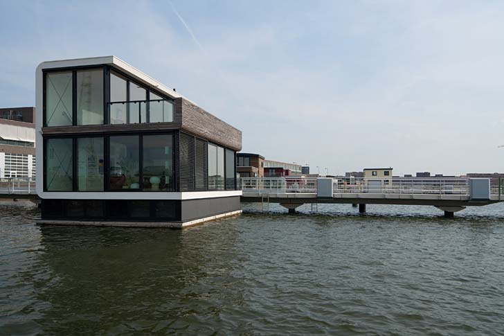 The Watervilla IJburg is a prototype for a floating house, designed by architect Koen Olthuis.  Designed to withstand rising water levels, as is common occurrence in the Netherlands, the Watervilla rises up and down with the tides, just like a