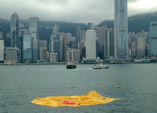 Florentjin Hoffman, floating art sculpture, floating rubber duck, giant rubber duck, Hong Kong, China, floating duck in Hong Kong, rubber duck deflates in Hong Kong, Victoria Harbor floating structure, news, art
