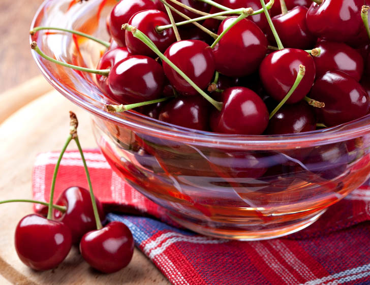 cherries in a glass bowl
