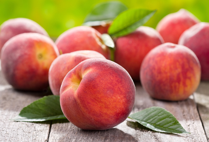 fresh peaches on wood table