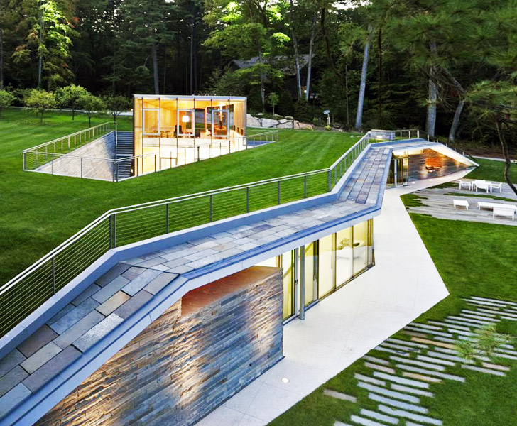 Gluck 39 s green roofed pavilion pool house melts into the for Pool show mi