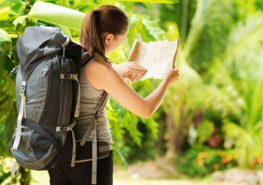 young woman, backpack, leave no trace, camping, map, preparation