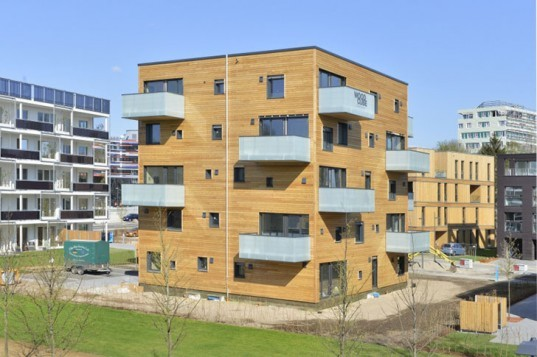 Woodcube carbon neutral five story wooden apartment building opens in hamburg inhabitat - Wooden cube house plans ...