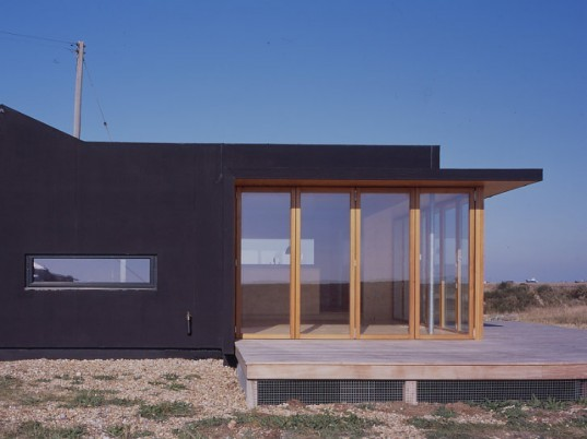 Black Rubber House, Simon Condor Associates, dungeness beach, beach house, rubber house, kent, green beach house