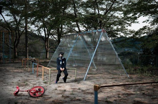 nuclear disaster of Fukushima, carlos ayesta, guillaume bression, photographs of fukushima, living in fear and uncertainty in fukushima, radiation poisoning fukushima, most affected parts of fukushima, plastic wrapped trees, business men in bubbles, women in gas masks