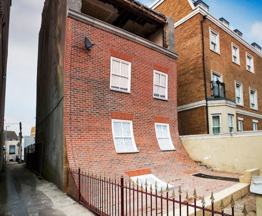 alex chinneck, from the knees of my toes to the belly of my toes, london, uk, kent, sliding brick wall, urban decay, optical illusion, brick facade, melting exterior, dezeen, margate, cliftonville