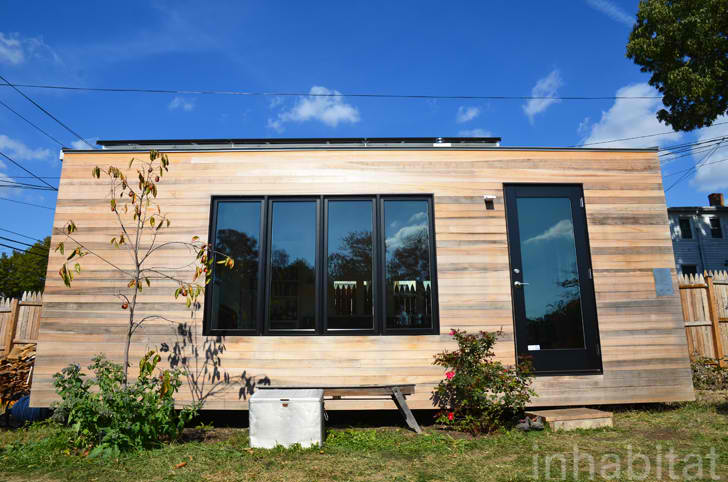 210 Sq Ft Minim House Shelters Sweet Space-Saving Interior with Off Grid Versatility