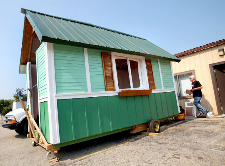 Occupy madison builds tiny homes for the homeless using for Recycled building materials los angeles