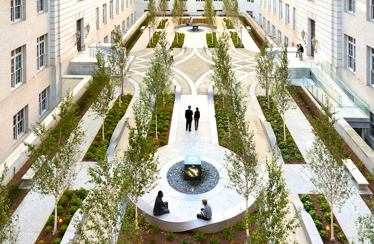Concrete ribbons add contemporary twist to historic for Courtyard landscape architecture