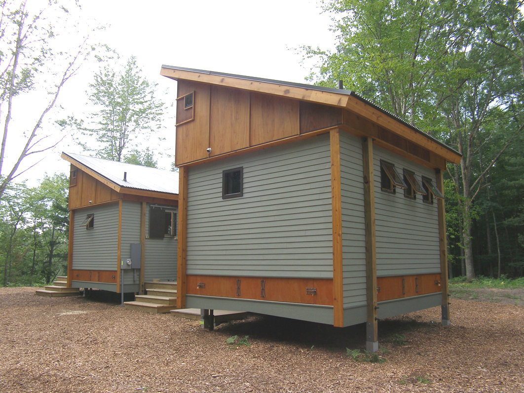 Compact modular pre fab cottage made from local materials for Prefabricated basement walls