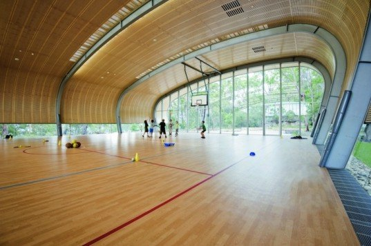 Milson Island Indoor Sports Stadium, canoe-inspired, Allen Jack+Cottier Architects, sydney, sports stadium, sports hall, multipurpose hall, plywood ceiling, arched frame, wind turbines, campsite, youth retreat, rainwater collection, rock garden