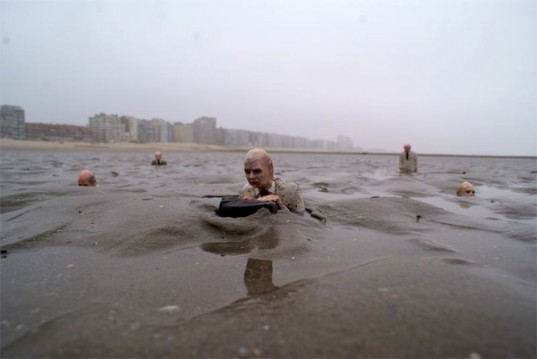 Isaac cordal, climate change, global warming, rising sea levels, tiny sculpture, cement art, cement sculptures, tiny figurines, follow the leaders, waiting for climate change, street art installations, street art interventions, social commentary