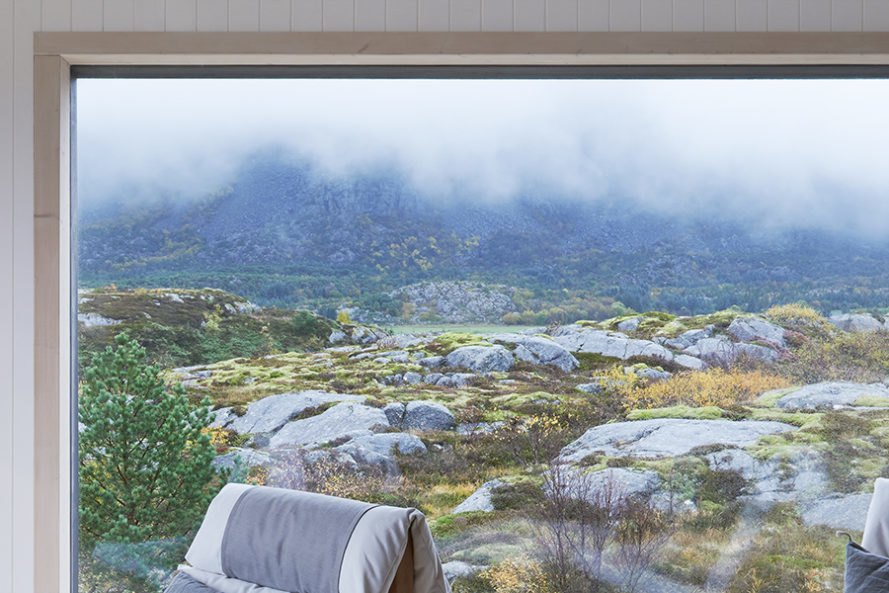 vega cottage, vega island, norway, arctic landscape, Kolman Boye Architects, rugged cabin, rugged cottage, cottage, gray patina, linseed oil painted pine, untreated birch, stone hearth, panoramic windows, timber facade