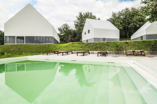 White Wolf Hotel, AND-RÉ hotel, pitched-roof houses, pitched-roof hotels, hotel Portugal, Portuguese architects, holistic design strategy, natural lighting, glass facades, daylit houses, pavilion-like hotels, pavilion architecture