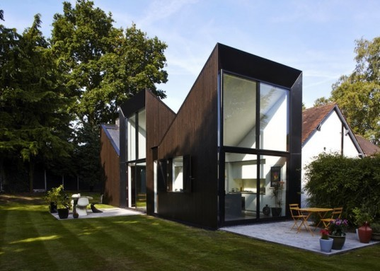 Blee Halligan Architects, bungalow triptych, pitch roof, house extension, machester, black stained timber, balck stained larch, sun's path, framed views, al fresco dining, solar heat gain, double height windows, timber porch,