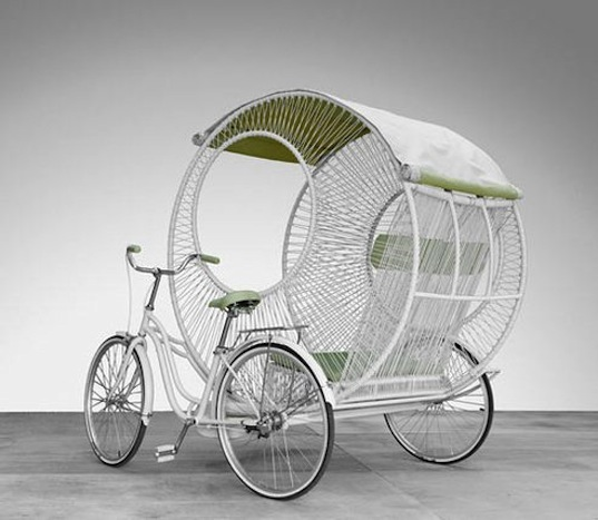 eclipse, Kenneth Cobonpue, pedicab, rickshaw, recyclable polyethylene, circular frame, green transportation, trishaw, bicycle spokes, aluminum frame, sustainable design, weatherproof vinyl, hand-stitched vinyl, insulated acrylic fabric, high tech rickshaw