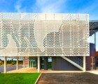 PAD Architects Wraps French Office with a Wavy Perforated Facade