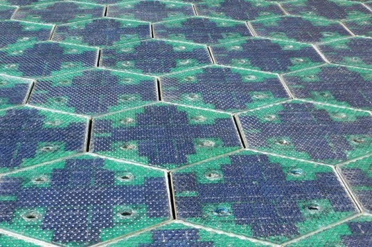 scott brusaw, julie brusaw, solar panel roadways, solar panel parking lots, replacing asphalt with solar panels, solar roadways, hexagonal road panels, solar road panels, solar parking lot panels, programmable LEDS, solar array, cable corridor, eliminating overhead power lines, cable tray in parking lot, parking lot that resdistributes storm water, stormwater harvesting, indiegogo,