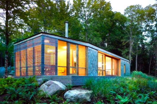 Stealth cabin eco retreat blends with the forest in for Energy efficient cabin