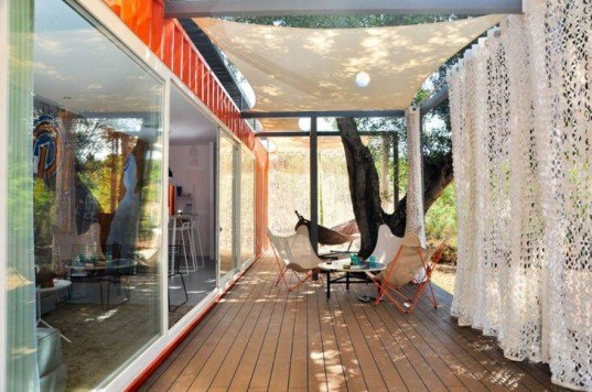 Nomad Living Container Guesthouse by Studio ArTe, repurposed shipping container, recycled shipping container, Nomad Living guesthouse by Arnold Aarssen, shipping container home, full-length sliding glass doors, shipping container homes in Portugal
