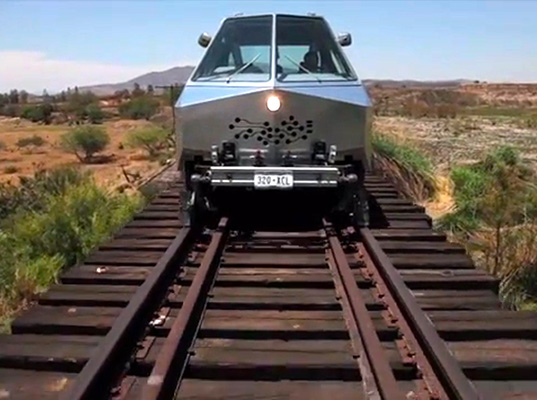 Funky Aluminum Hybrid Vehicle Travels On Railways To Reach