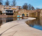 Floating Wooden Bridge Lets You Walk on Water to a Centenary Fortress in the Netherlands
