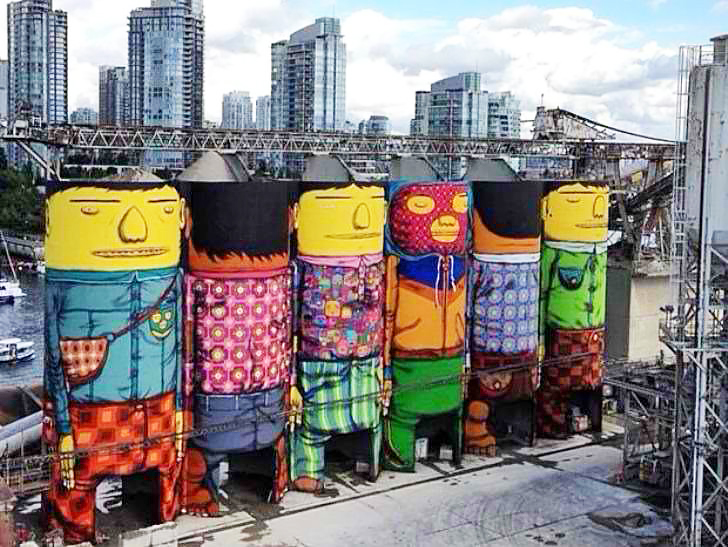 giants os gemeos convert six enormous silos into awesome works of colorful street art in. Black Bedroom Furniture Sets. Home Design Ideas