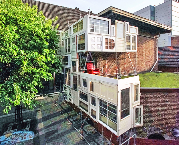 Bow House Fascinating Parasitic Home Built From A