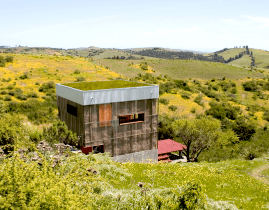 green roof, wood cabin, cabin, AATA Architects, Chile, navidad, Chilean architecture, thermal efficiency, minimal carbon footprint, waved zinc, straw bales, mud-coated straw bales, polycarbonate,