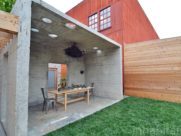 bunker like concrete home hides a courtyard and a tree
