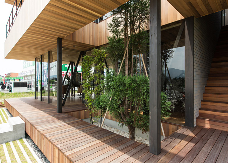 Hamada S Glass Wood Building Wraps Around Living Trees