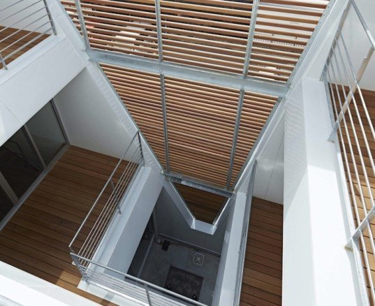 House in Tatemachi, Masao Yahagi Architects, Kitakyushu, Japan, cone-shaped void, natural daylight, ventilation, privacy, wooden louvers, open tread stairs, inner courtyard,