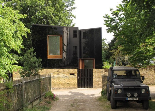 Ian McChesney, London architecture, black glass, glass facade, London architects, wood-burning stove, small houses, Victorian architecture London, Invisible home