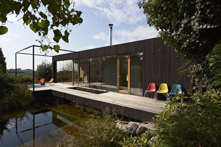 Small Spruce Clad Home Sits On Stilts Above A Natural