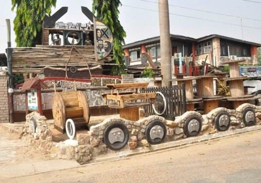 Wheel Story House, Ghana, Accra, Sammy Mensah Ansah, upcycle, reclaimed wood, recycled materials, reclaimed materials, house made from trash, trash construction materials, upcycled construction materials, west africa