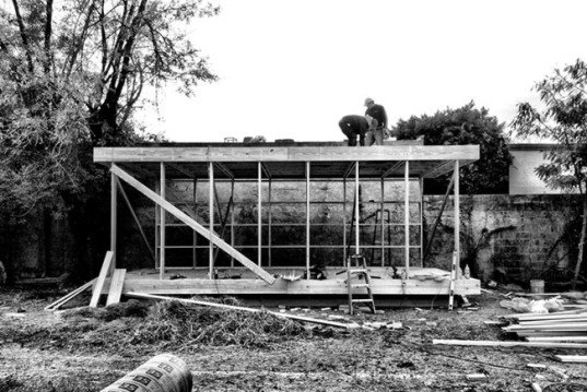 S-AR architects, casa de madera, minimalist house, wood house, overbuilt cities, floating house, glass panels, modular pinewood structural elements, extruded polystyrene panels, wood columns, floor decking, metal roof, sleep and study, wood cylinder bathroom, passive cooling, poetic space
