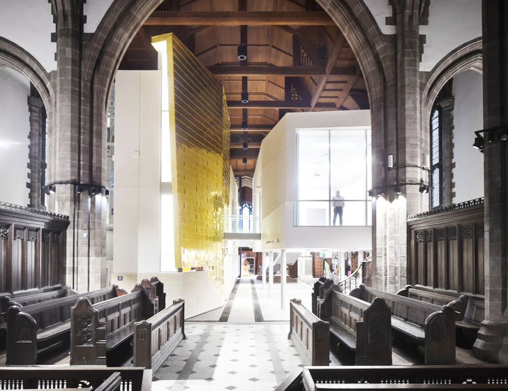 OMI Architects Insert Two Multi Functional Pods Into A 19th Century Church In Bolton UK