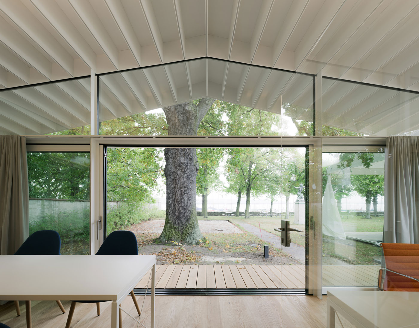elegant glass and steel study pavilion boasts picturesque lakeside